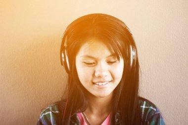 Beautiful asian girl listening music