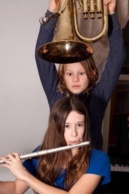 Girls fooling around with instruments