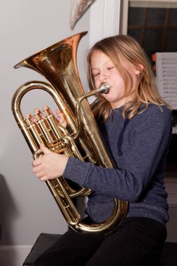 Girl playing baritone