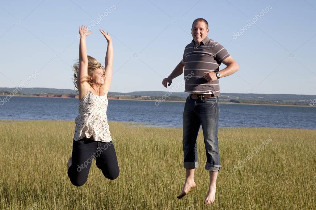 jumping by ocean