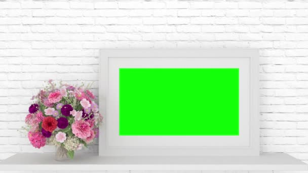 Frame and flower with track green screen on table