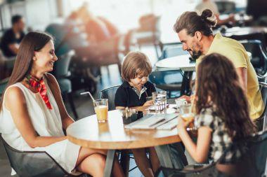 attractive family in restaurant