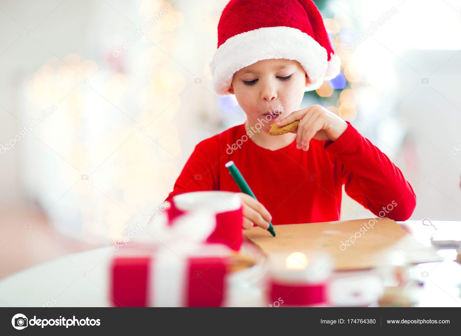 Little happy boy writing letter santa claus red hat stock photo little happy boy writing letter santa claus red hat stock photo spiritdancerdesigns