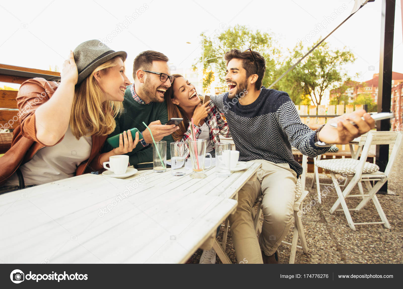 Group Happy Young People Cafe Talking Laughing Together Stock Photo C Adriaticphoto 174776276