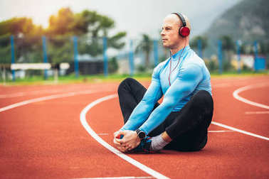 man exercising at race track