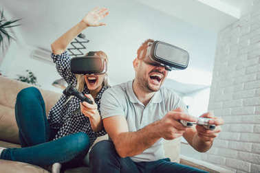 Happy friends playing video games with virtual reality glasses - Young people having fun with new technology console online