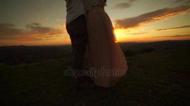 Asian couple enjoying a sunrise