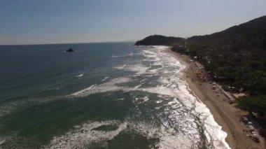 Tropical sandy beach and waves