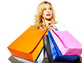 portrait of beautiful cute happy sweet smiling blonde woman girl holding in her hands big shopping colorful bags in  hipster clothes isolated on white