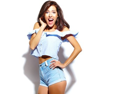 portrait of cheerful smiling fashion  girl going crazy in casual blue hipster summer clothes with no makeup on white background