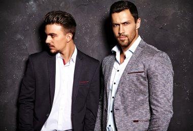 Two handsome men in elegant suits