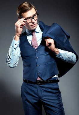 handsome businessman male model in blue suit  posing in studio