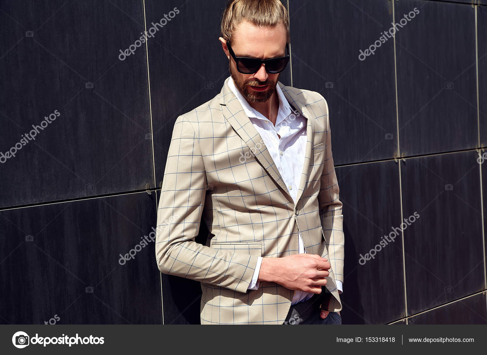Portrait Of Sexy Handsome Fashion Male Model Man Dressed In Elegant Checkered Suit Posing Outdoors On