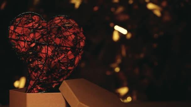 heart paper box dark background gold bokeh hd footage
