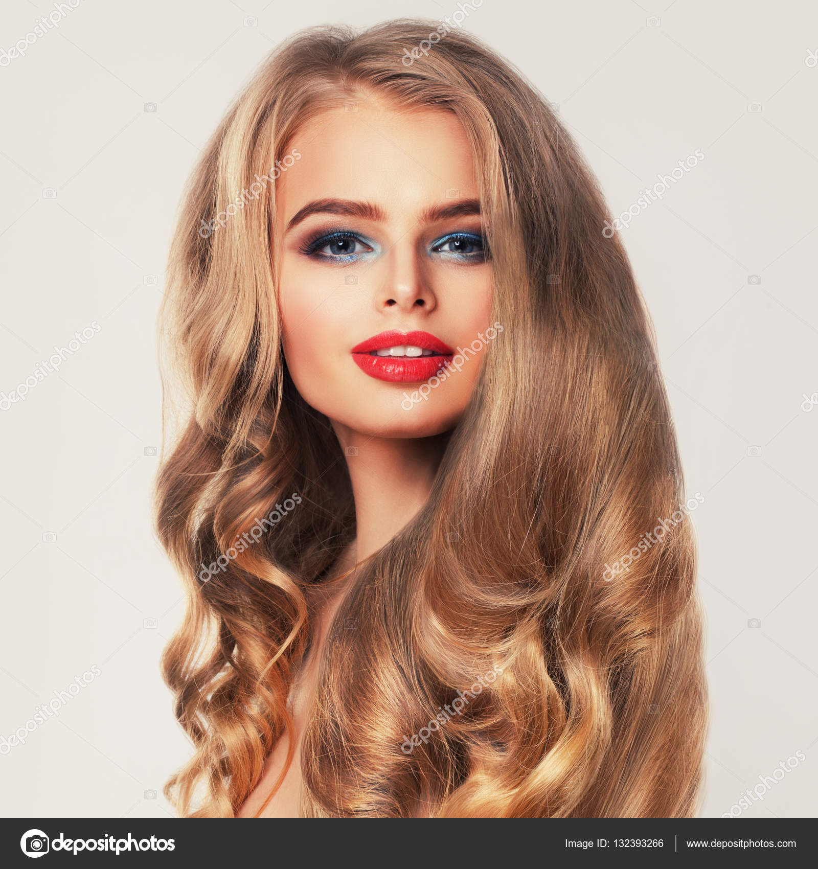 Healthy Woman With Long Blonde Hair And Makeup. Permed Hairstyle U2014 Stock  Photo