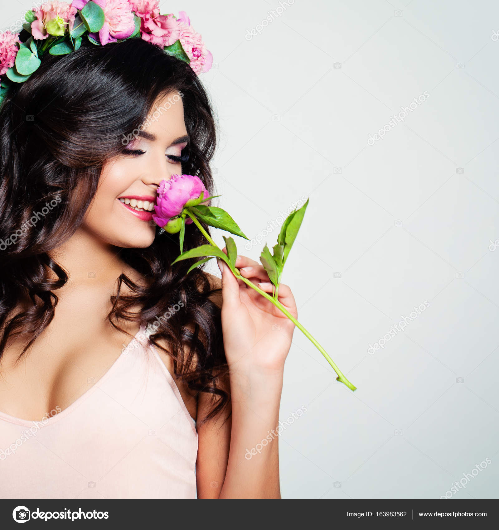 Beautiful woman with rose flower wreath spring beauty stock beautiful woman sniffing a flower blonde beauty long permed curly hair and fashion makeup beauty girl with flowers hairstyle photo by millafedotova izmirmasajfo