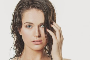 Portrait of nice model woman with wet skin