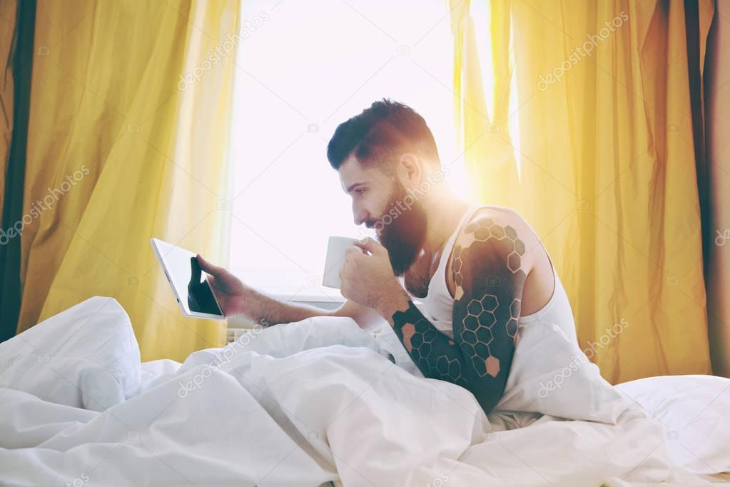 Bearded man  and digital tablet
