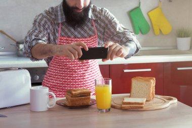 man making photo of morning breakfast