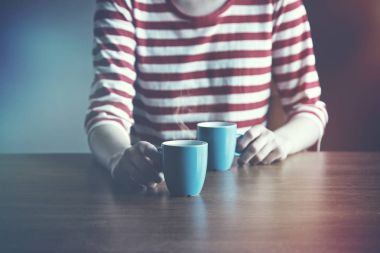 girl with two cups of coffee