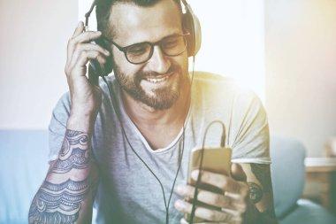 smiling man listening to music