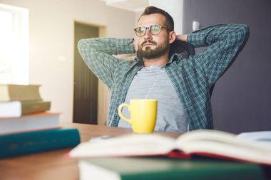 man has break resting after reading work