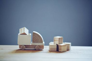 Wooden model of truck loading freight. Shipping and delivery concept