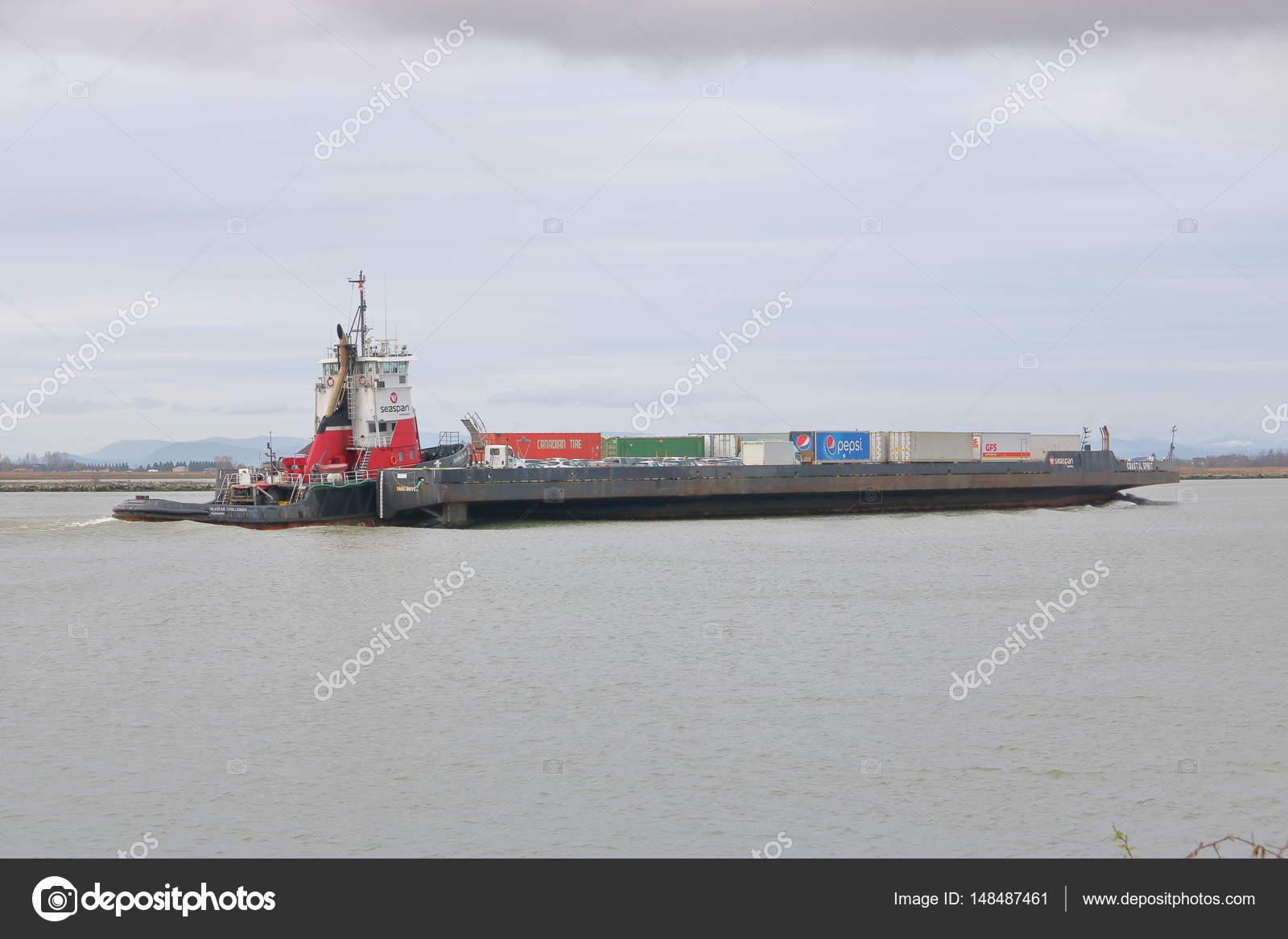 Flat Top Barge Carrying Cargo Bins – Stock Editorial Photo