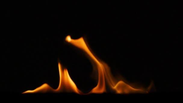 égő láng