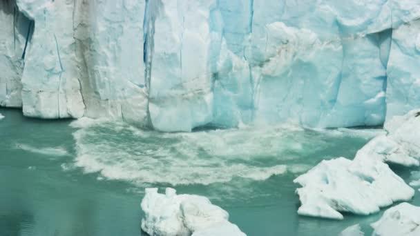 Breaking of Ice Chunks Along Perito Moreno Glacier Falling Into the Water