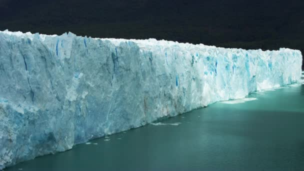 Steady Timelapse Shot of Edge of Glacier Surrounded by Ice-Cold Water Lake