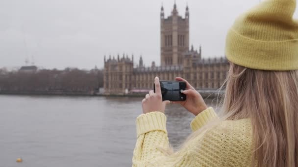 Teenage Tourist Filming With Smartphone Over City River