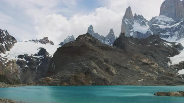 Timelapse Shot of the Scenic El Chalten Mountains Partially Covered with Snow