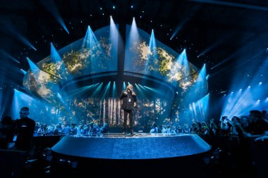 KYIV, UKRAINE - MAY 08, 2017:   Salvador Sobral from Portugal at the first semi-final rehearsal during Eurovision Song Contest, in Kyiv, Ukraine stock vector