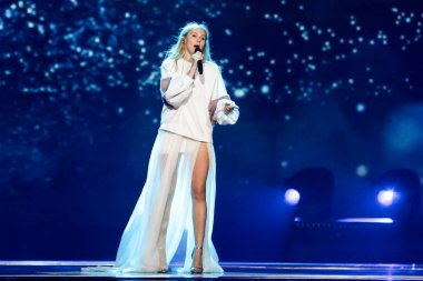 KYIV, UKRAINE - MAY 12, 2017:   Kasia Mos from Poland at the Grand Final rehearsal during Eurovision Song Contest, in Kyiv, Ukraine stock vector