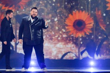 KYIV, UKRAINE - MAY 12, 2017:  Jacques Houdek from Croatia at the Grand Final rehearsal during Eurovision Song Contest, in Kyiv, Ukraine stock vector