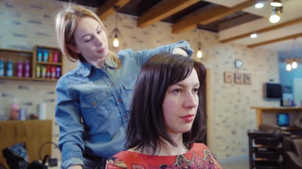 Woman Getting New Haircut By Hairdresser At Parlor Stock Video