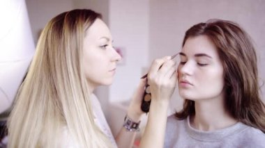 Brow master paints models eyebrow