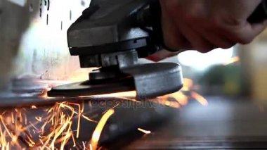 Industrial worker grinding metal