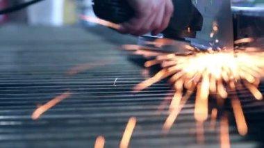 Industrial worker grinding metal