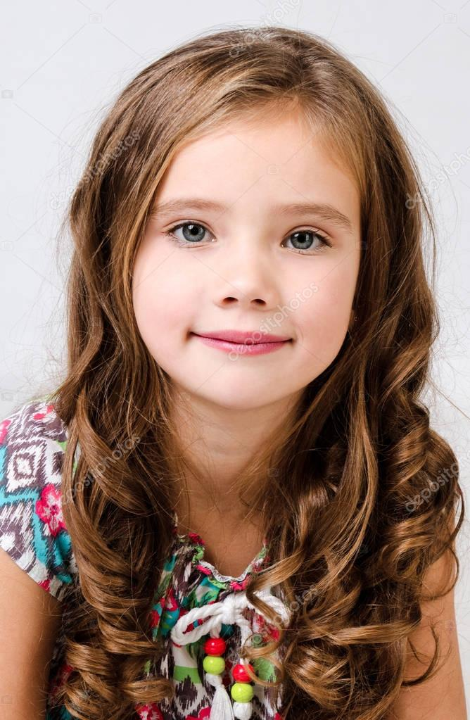 Portrait Of A Smiling Hispanic Pretty Young Girl Stock