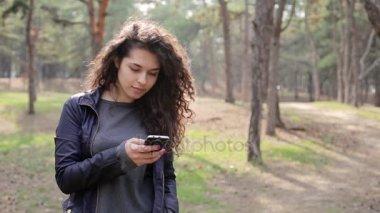 Brunette Woman using mobile