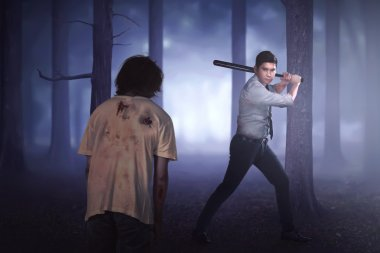asian man killing zombie with bat