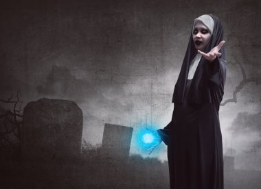 Awful asian woman nun with magic blue power