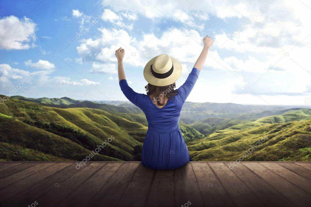 woman enjoying panorama of mountains