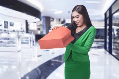 business woman opening hopping bag