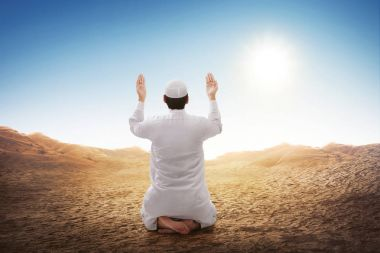 asian muslim man sitting and praying