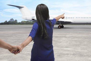 Asian couple heading to plane