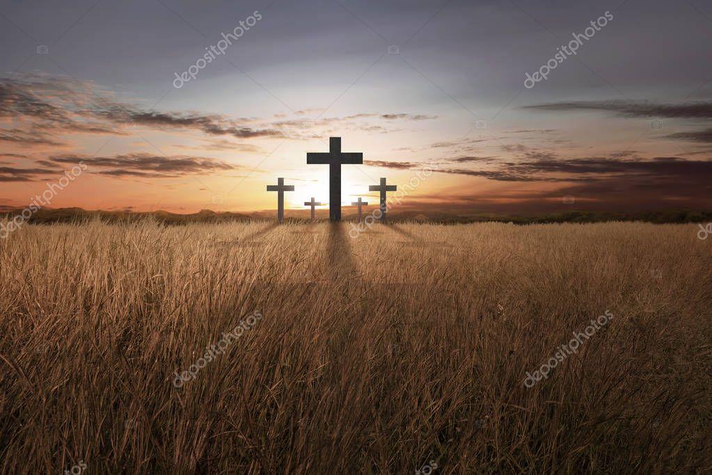 Bright christian cross at sunset