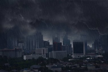 Dark rain clouds with lightning storm in city